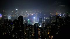 The Hong Kong Skyline at Night with view of the Harbor  - Hong Kong China Stock Footage