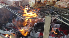 Outdoor Barbecue Cooking Flames - Meat on the Grill Stock Footage
