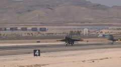 F-16C Fighting falcon jet fighter lands at Red Flag Stock Footage
