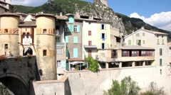 Stock Video Footage of People walking in the entrance of the medieval city of Entrevaux, France