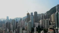 Time Lapse Pan of the Hong Kong Skyline from Rooftop Location  - Hong Kong China Stock Footage