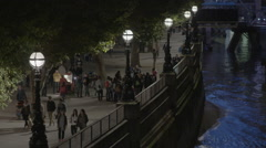 Pedestrians on South Bank walking along the Thames - stock footage