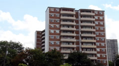 Generic Apartment Building with Clouds moving in behind.  CC Flat. Arkistovideo