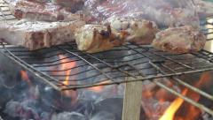 Coals and Flames Cooking Meat - Cookout Stock Footage