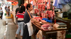 Street Butcher Selecting Cuts of Meat - Hong Kong Stock Footage