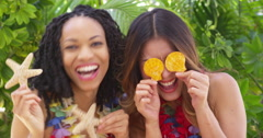 Best friends goofing around on tropical vacation Stock Footage