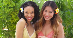 Beautiful African American and Asian women on vacation together Stock Footage