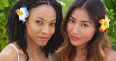 Close up of Beautiful African American and Asian women on vacation together Stock Footage