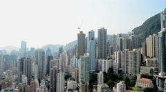 Time Lapse Pan of the Hong Kong Skyline from Rooftop Location  - Hong Kong China - stock footage
