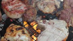 Turning meat on the Barbecue - Close Up Stock Footage