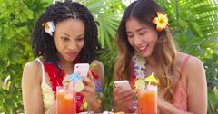 Two fun girls taking selfie on tropical vacation Stock Footage