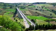 From the top shot of fast motion highway in the middle of the countryside. Stock Footage
