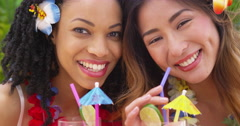 Close up of Beautiful African American and Asian women on vacation together - stock footage