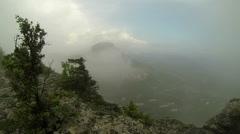 Rain in the mountains. Cave city Tepe-Kerman, Crimea, Russia, Full HD,  Stock Footage