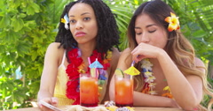 Bored friends sitting at table on tropical vacation Stock Footage