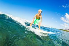 Boy surfing ocean wave Kuvituskuvat