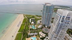 Aerial building flyover Continuum Miami Beach Stock Footage