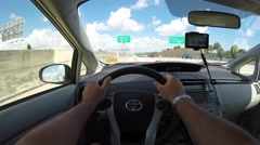 Man driving a prius Stock Footage