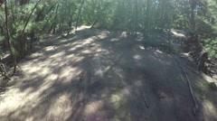 Mountain biking on a trail 4k video Stock Footage