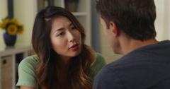 Boyfriend telling his Japanese girlfriend bad news Stock Footage