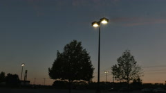 2300 Street Lights in Parking Lot at Sunset, 4K  Stock Footage