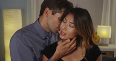 Mixed raced couple being intimate Stock Footage