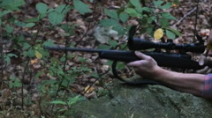 Stock Video Footage of 2305 Man Firing Hunting Gun in Slow Motion