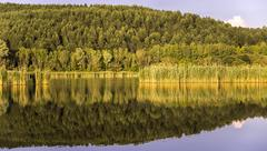beautiful landscape reflection in the lake. - stock photo