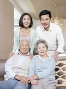 two generation asian family - stock photo