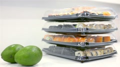 Several large portions of sushi in the plastic bowl Stock Footage