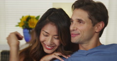 Portrait of cute mixed race couple being affectionate Stock Footage