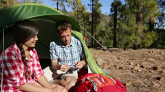 Camping couple in tent taking smartphone selfie self portrait photo Stock Footage