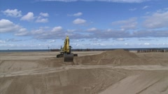 Excavator operating at construction site Kust op Kracht, extending the beach Stock Footage
