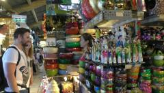 Tourists buy souvenirs at the market in Vietnam Stock Footage