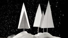 Christmas winter papercraft scene on dark background Stock Footage