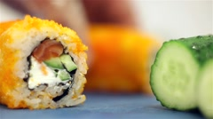 Cutting of sushi roll Stock Footage