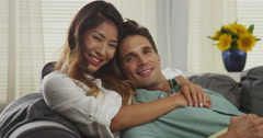 Attractive mixed race couple smiling at camera Stock Footage