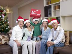 Asian family with christmas hats Stock Photos