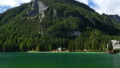 Pan over lake prags in dolomites alps 11518 Stock Footage