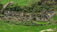 Stock Video Footage of Zoom Out - Above View of Abandon Buildings with Rice Terraces - Vietnam