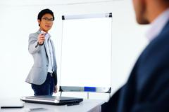 Stock Photo of portrait of a businessman presenting something on a meeting