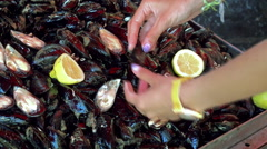 Buyer of fresh mussels at the Catania fish market.  Sicily Stock Footage