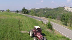 Tractor mows the grass on the mountains1.mp4 Stock Footage