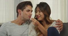 Japanese girlfriend feeding her boyfriend Stock Footage