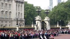 Buckingham Palace Crowds with police horses moving right to left with guards  Stock Footage