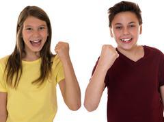 Kinder oder teenager ballen die faust mit erfolg beim siegen oder gewinnen Stock Photos