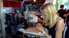 Girl tries fresh mussels at the Catania fish market. Sicily Stock Footage