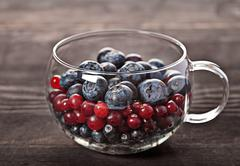 Berries assortment in glass bowl Stock Photos