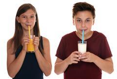 Healthy eating children drinking milk and orange juice Stock Photos