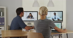 Business colleagues working together over the internet - stock footage